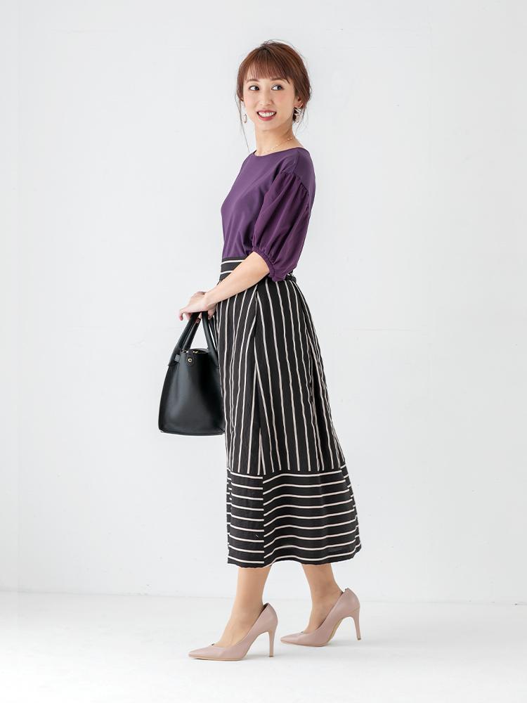 「それだけで気品がぐっと高まるパープルは、オフィスでも上質なレディムードを醸し出してくれること間違いなし。深みのあるカラーで甘さをセーブしたストライプ柄のスカートで知的にまとめて、大人のフェミニンを意識して」(スタイリスト・杉本知香さん)